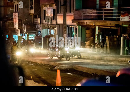 Motorists passing through an under construction road in the night, one year after the 2015 Nepal earthquakes. Kathmandu, - Stock Photo