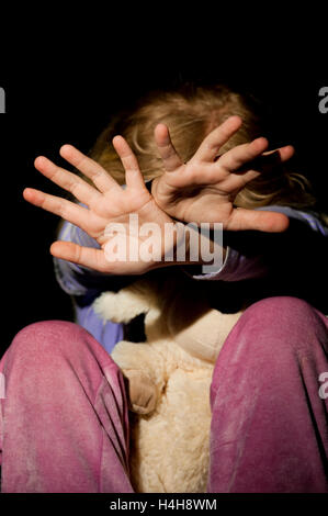 Girl struggles with outstretched hands