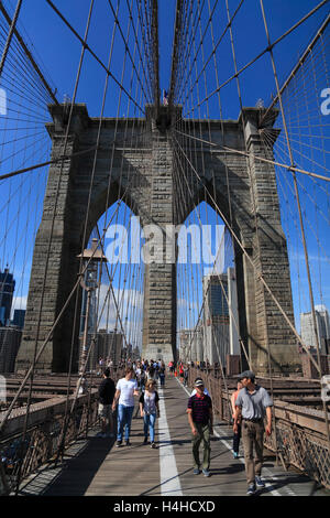 Tourists on  Brooklyn Bridge, New York, USA - Stock Photo