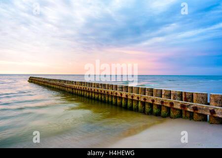 Beautiful sunset on beach in Leba coastal town, Baltic Sea, Poland - Stock Photo