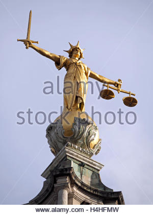A close-up view looking up at the Lady Justice statue on The Central Criminal Court aka the 'Old Bailey' in London - Stock Photo