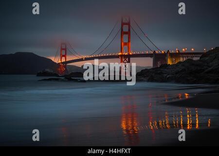 The Golden Gate Bridge at dusk, photographed from Baker Beach - Stock Photo