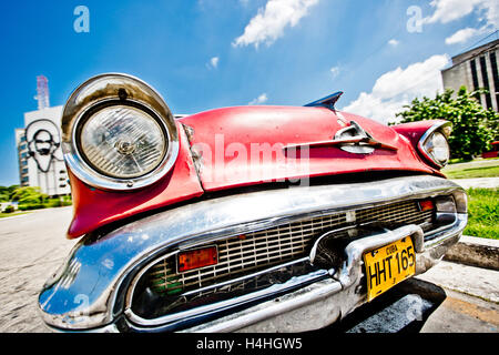The front of a vintage old America car - a red Chevrolet, parked in the street in Havana, Cuba, Caribbean - Stock Photo