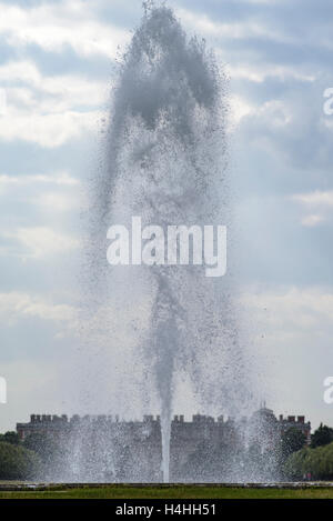 A fountain in front of Hampton Court Palace - Stock Photo