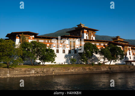 View across river to Punakha Dzong, a huge fortress monastery and administrative building in Bhutan - Stock Photo