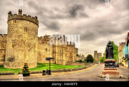 Statue of Queen Victoria and walls of Windsor Castle - England - Stock Photo