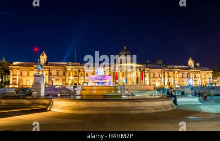 Fountain and the National Gallery on Trafalgar Square, London - Stock Photo