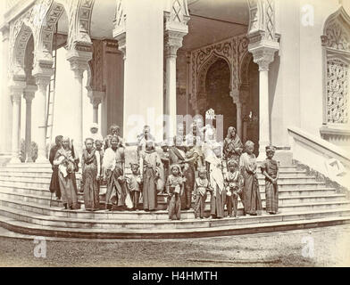Group portrait of Indian women and children on the steps of the Grand Mosque in Banda Aceh, Indonesia, Anonymous - Stock Photo