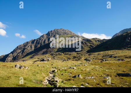 Path to Mount Tryfan showing profile of North Ridge and Bristly Ridge from west side in Snowdonia National Park. Ogwen Wales UK Britain
