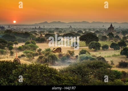 Scenic sunrise above Bagan in Myanmar. Bagan is an ancient city with thousands of historic buddhist temples and - Stock Photo