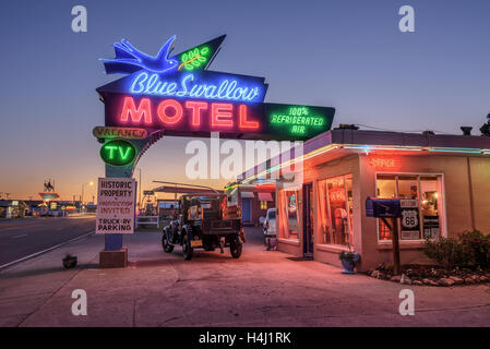 Historic Blue Swallow Motel with a vintage car parked in front of it during the blue hour - Stock Photo