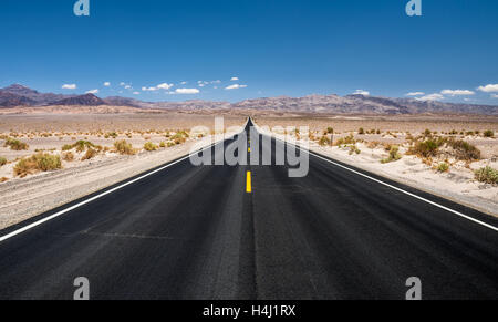 Long empty road running through Panamint Valley in Death Valley National Park, California - Stock Photo