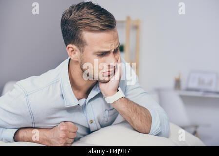 Young handsome man having a toothache. - Stock Photo