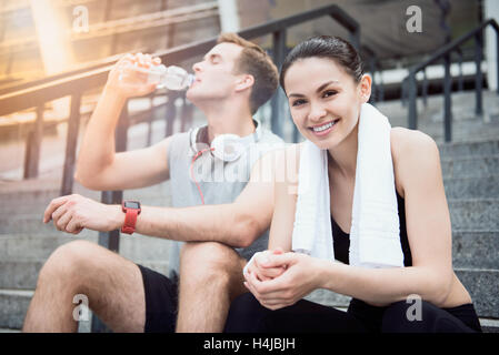 Smiling friends waiting for training near the stadium - Stock Photo
