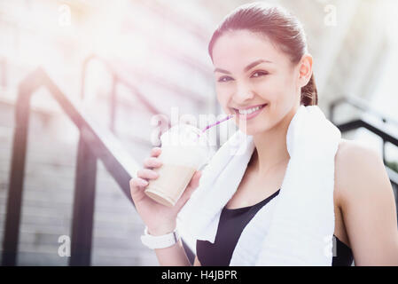 Beautiful young sporty woman relaxing after fitness. - Stock Photo