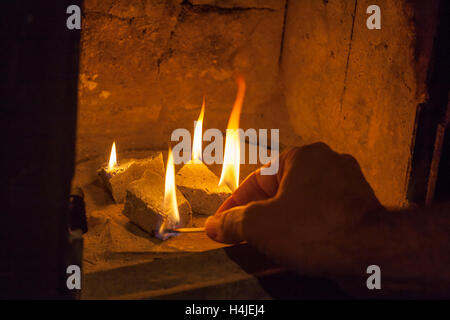 lighting a wood burner stock photo royalty free image. Black Bedroom Furniture Sets. Home Design Ideas