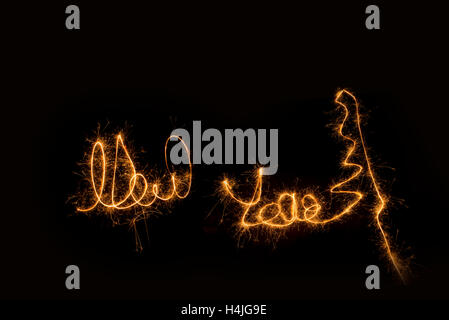 New year written with sparks. Long exposure technic. - Stock Photo
