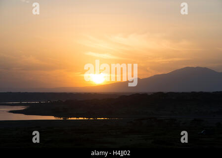 Sunrise over Lake Ndutu, Serengeti National Park, Tanzania - Stock Photo
