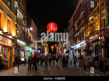 Pedestrians on Wardour Street, Nocturnal street scene, Chinatown, Soho, London, England, United Kingdom - Stock Photo
