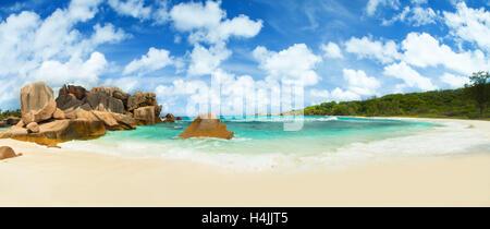 Beautiful Seychelles tropical beach Anse Coco at La Digue island - Stock Photo