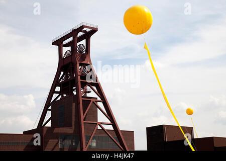 Yellow balloon, Schachtzeichen, mine shaft signs, Ruhr 2010, art installation, head frame of pit XII, Zeche Zollverein - Stock Photo