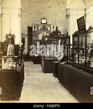 Display cabinets with objects in the exhibition of National Industry and Art in the Palace of Industry, Amsterdam - Stock Photo