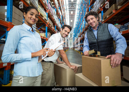 Portrait of warehouse workers preparing a shipment - Stock Photo