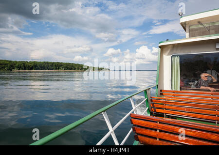 Excursion ship with tourists on the Chiemsee. Upper Bavaria. Germany. - Stock Photo