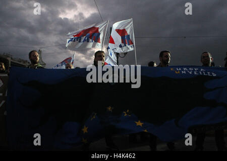 Athens, Greece. 17th Oct, 2016. Supporters of the communist-affiliated union PAME take part in an anti-austerity - Stock Photo