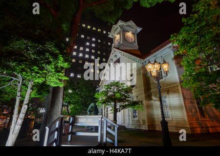 The historical Sapporo Clock Tower (Tokeidai) in night at Sapporo, Hokkaido, Japan - Stock Photo