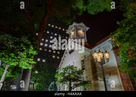 The historical Sapporo Clock Tower (Tokeidai) in night at Sapporo, Hokkaido, Japan - Stock Photo