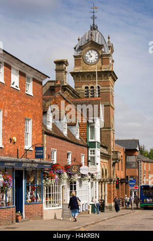 England, Berkshire, Hungerford, High Street, Town Hall tower and shops - Stock Photo