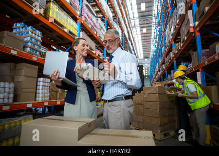 Warehouse manager and client interacting with each other - Stock Photo