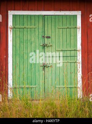 Image of green barn doors. - Stock Photo