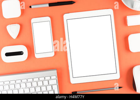 Responsive design: Keyboard, tablet and smartphone on red table - Stock Photo