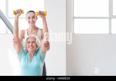 Happy young coach working out with the client - Stock Photo