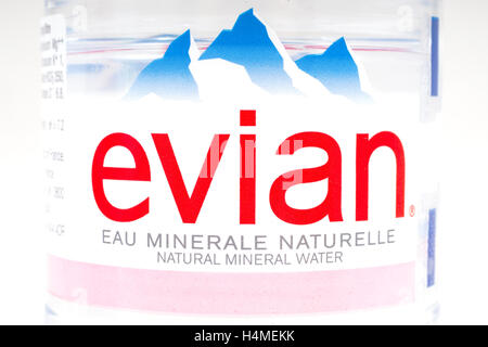 LONDON, UK - OCTOBER 13TH 2016: A close-up of the label on a bottle of Evian Natural Mineral Water. - Stock Photo