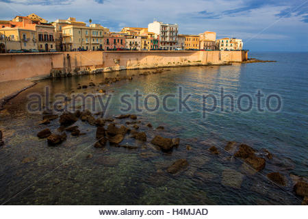 Colorful, centuries-old buildings along the sea wall of the Mediterranean island of Ortigia in Syracuse, Sicily. - Stock Photo