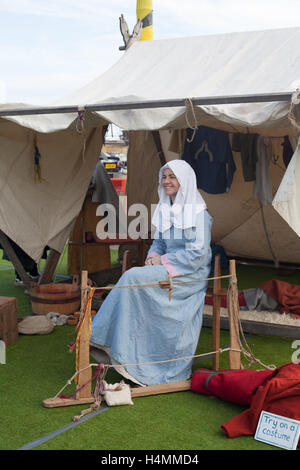 A woman dressed in medieval clothes during the 950th anniversary of the Battle of Hastings, Sussex, UK - Stock Photo