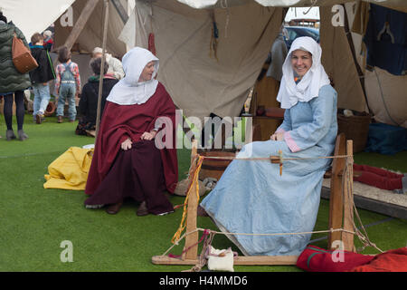 Two ladies dressed in medieval clothes during the 950th anniversary of the Battle of Hastings, Sussex, UK - Stock Photo