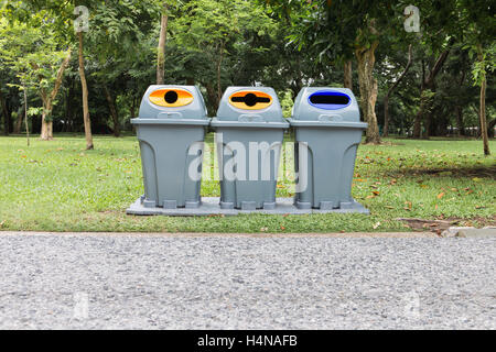 Three type of trash bin,Recycle in the park - Stock Photo