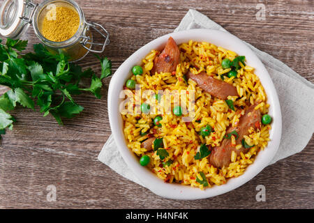 rice with meat curry green peas cooked - Stock Photo