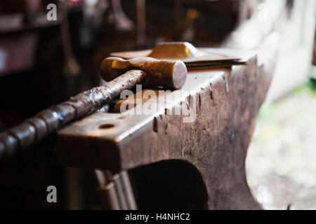 colonial blacksmith workshop. close up of a metal hammer lying on anvil in blacksmith\u0027s workshop. - stock colonial blacksmith workshop