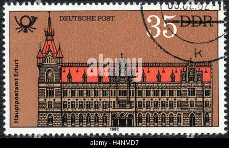 A postage stamp printed in DDR  Germany shows Post office in Erfurt,  1982 - Stock Photo