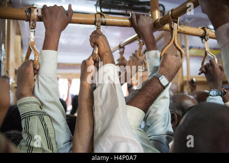 India,Indian,Asian,train,rail,railway,carriage,Strap hanging commuters,passengers, on suburban train heading home - Stock Photo