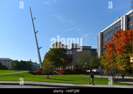 USA Pittsburgh PA Pennsylvania university campus of Carnegie Mellon fall with art piece 'Walking to the Sky'  Jonathan - Stock Photo