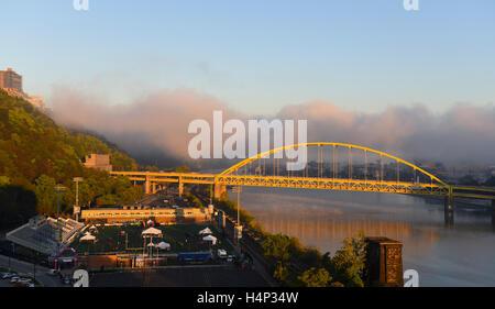 USA Pittsburgh PA Pennsylvania Low fog on the Ohio and Monongahela Rivers Fort Pitt Bridge - Stock Photo