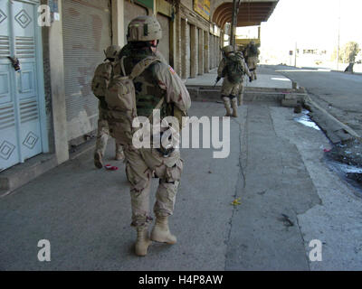 3rd December 2004 U.S. Army soldiers of the 1st Battalion, 24th Infantry Regiment, 'Deuce Four', on the streets - Stock Photo