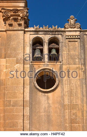 A centuries old stone and stucco building with a bell tower on an inactive estate in rural Sicily, Italy. - Stock Photo