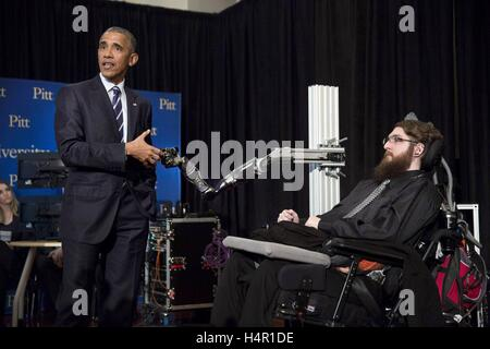 U.S President Barack Obama fist-bumps the robotic arm of Nathan Copeland during the the White House Frontiers Conference - Stock Photo